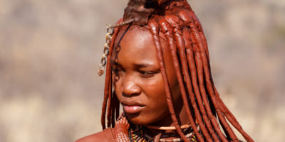 Kamanjab, Namibia - October 10, 2014: Himba tribe woman with ornaments on the neck, in the village of Himba people near Kamanjab in northern Namibia